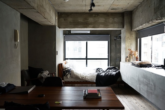 A room with a bright window and sparse decorations