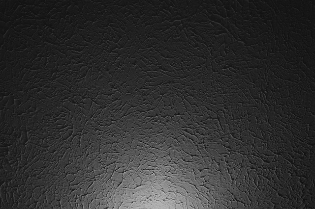 A stucco ceiling with a hint of light at the bottom