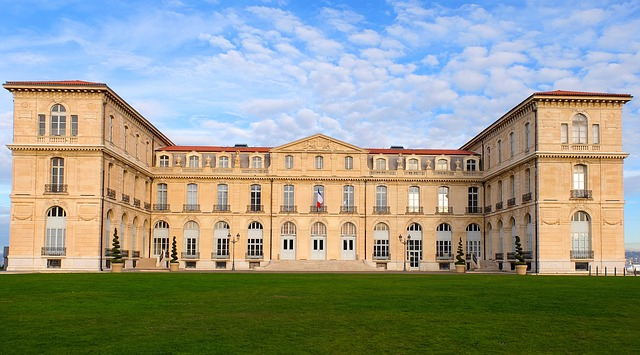 A historic Marseilles palace with a green lawn