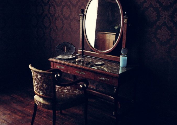 A Victorian-style vanity and mirror