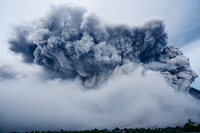 An enormous gray smoke cloud fills the entire frame